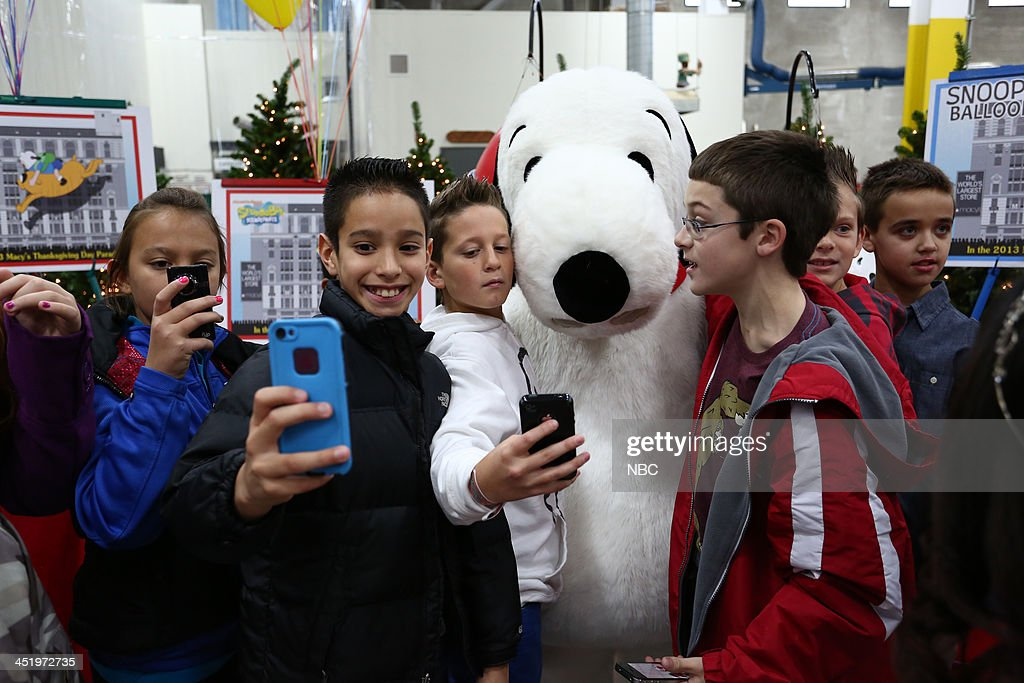 Spectators pose with Snoopy --