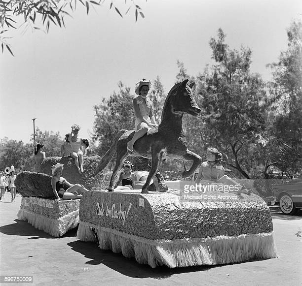 A float with cowgirls enter the 1958 Rose Parade in Pasadena California