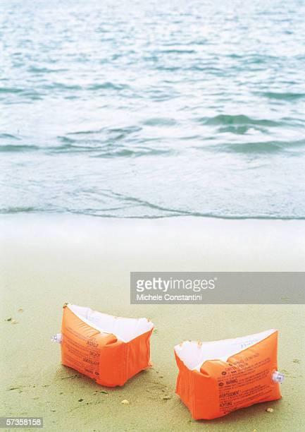 Floaties on beach
