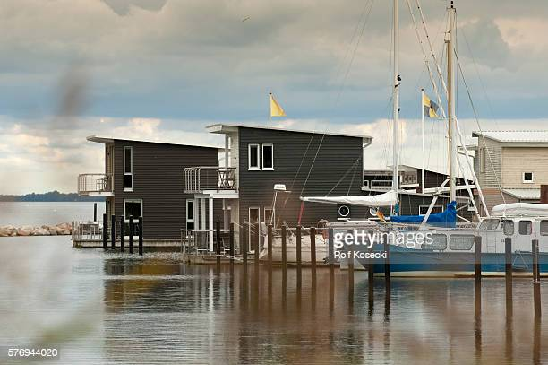 floating cottages imjaich Water Holiday World in port on September 28 2013 in Lauterbach Germany