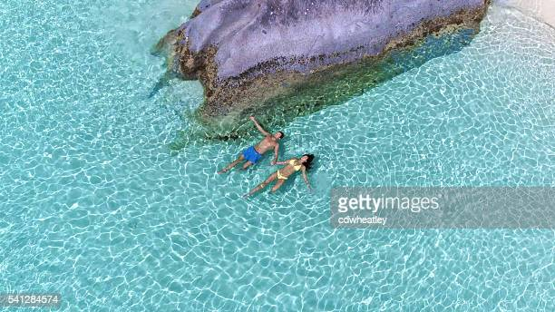 floating couple on perfect beach in Virgin Gorda, BVI