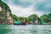 Floating fishing village and rock island at Lan Ha Bay, Ha long Bay tour in Vietnam