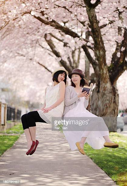 Floating Girls infront of Cherry Blossoms