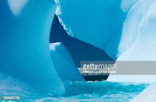 Floating icebergs framing a view of the ocean, Antarctica : Stock Photo