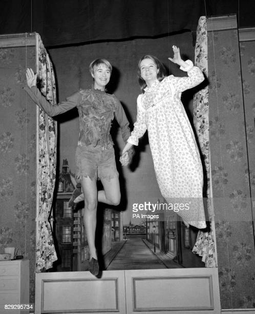 Floating into the festive scene come Peter Pan left and Wendy during a training flight over the stage of the Scala Theatre London