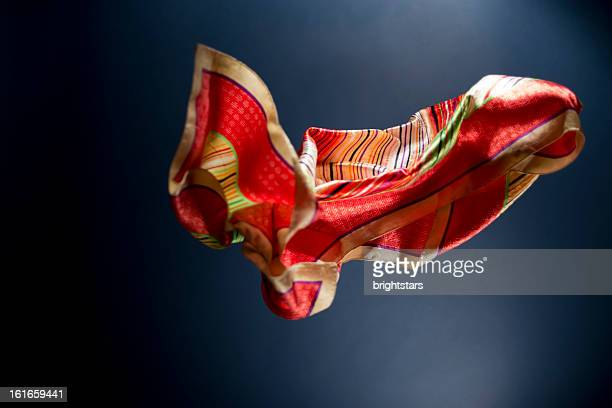 Floating multicolored scarf on a blue background