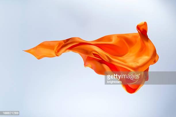 Floating orange silk on a bright background