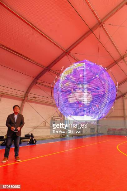 A floating sphere spaped drone display developed by mobile phone giant NTT DoCoMo is unveiled on April 20 2017 in Tokyo Japan The drone fourroter...