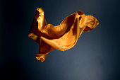 Floating yellow satin on a dark blue background