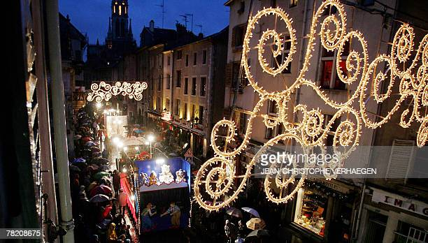 Floats are seen in streets enlighten with Christmas decorations during the Santa Klaus parade in Nancy eastern France 02 December 2007 AFP PHOTO...