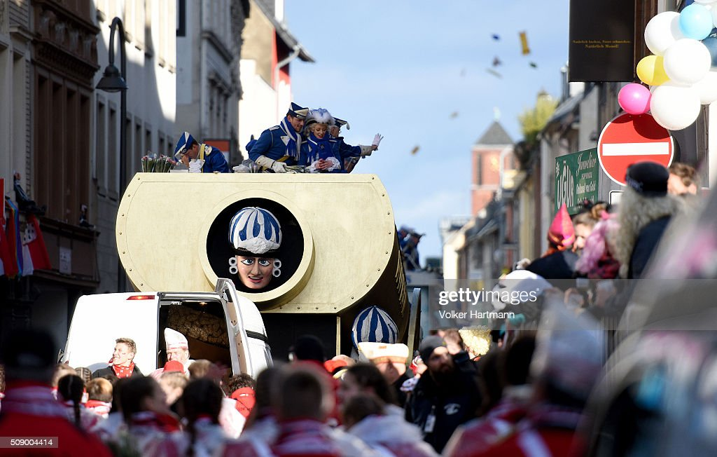 Floats drive through carnival revellers during the annual Rose Monday parade on February 8, 2016 in Cologne, Germany. The centuries-old tradition of German carnival occurs in February and runs until Ash Wednesday, the start of Lent, and culminates in Rose Monday celebrations. Police are on added alert this year, particularly in Cologne, due to the New Year`s Eve sex attacks on women that have been attributed to gangs of migrants.