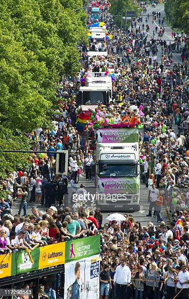 Floats make their way towards the Brandenburg Gate during Berlin's annual Christopher Street Day parade June 25 2011 Gays and lesbians all around the...