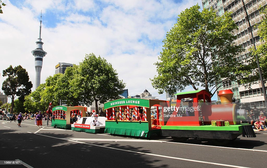 Floats parade down the street during the annual Farmers Santa Parade on November 25, 2012 in Auckland, New Zealand. For 78 years the Farmers Santa Parade has brought joy to the children of Auckland marking the start of the Christmas season.