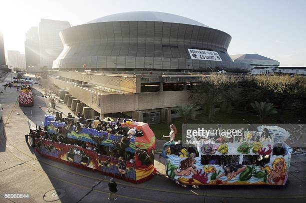 Floats pass the Superdome before the beginning of the Zulu Parade during Fat Tuesday Mardi Gras festivities February 28 2006 in New Orleans New...