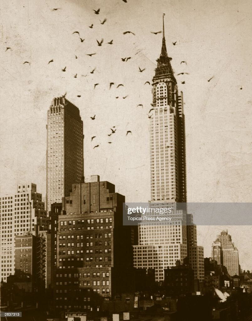A flock of birds flying in front of the nearly-completed Chrysler Building in New York City. Designed by William Van Alen.
