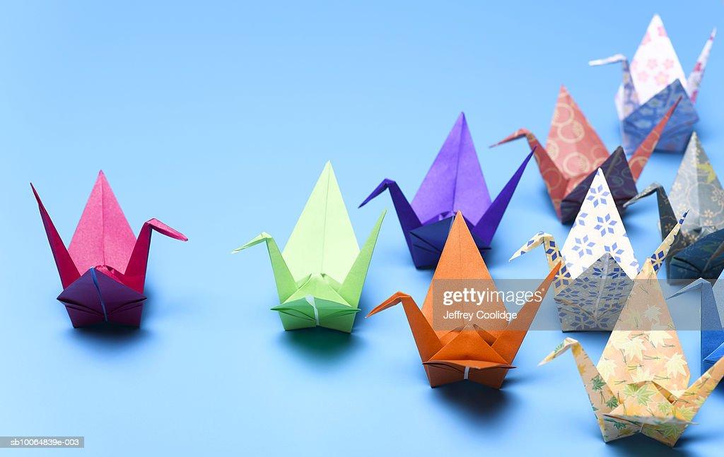 Flock of origami cranes : Stock Photo