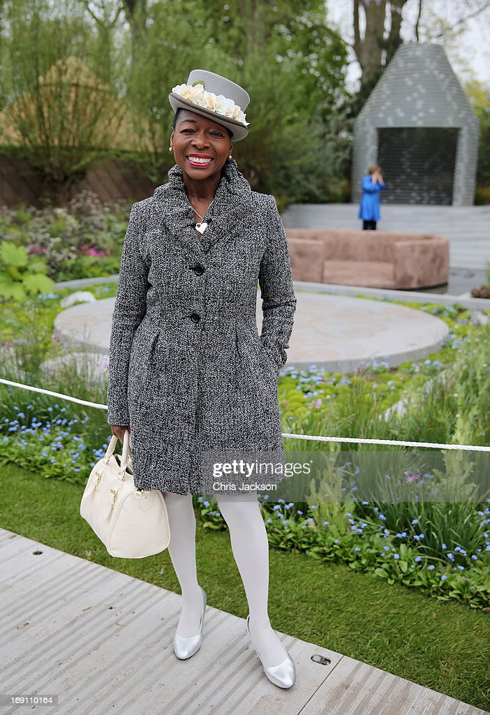 Floella Benjamin poses in the B&Q Sentebale 'Forget-Me-Not' Garden at the Chelsea Flower Show at Royal Hospital Chelsea on May 20, 2013 in London, England. The B&Q Sentebale 'Forget Me Not' Garden was designed by renowned garden designer Jinny Blom and includes native Lesotho flowers and a contemporary pavilion based on a Traditional Basotho roundhouse. The garden was built to raise awareness of the work of Prince Harry's charity Sentebale and the plight of the children of this small African Kingdom.