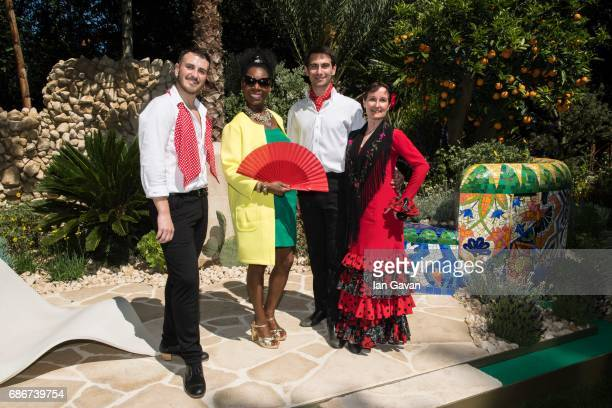 Floella Benjamin poses with traditional Spanish flamenco dancers at the RHS Chelsea Flower Show on May 22 2017 in London United Kingdom With Their...