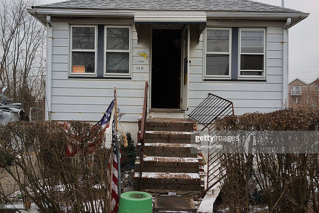 A flood damaged home is viewed in Oakwood Beach in Staten Island on February 5, 2013 in New York City. In a program proposed by New York Governor Andrew Cuomo, New York state could spend up to $400 million to buy out home owners whose properties were destroyed by Superstorm Sandy. The $50.5 billion disaster relief package, which was passed by Congress last month, would be used to fund the program. If the program is adopted, homeowners would be relocated and their land would be left as a natural barrier to help absorb future floods waters.