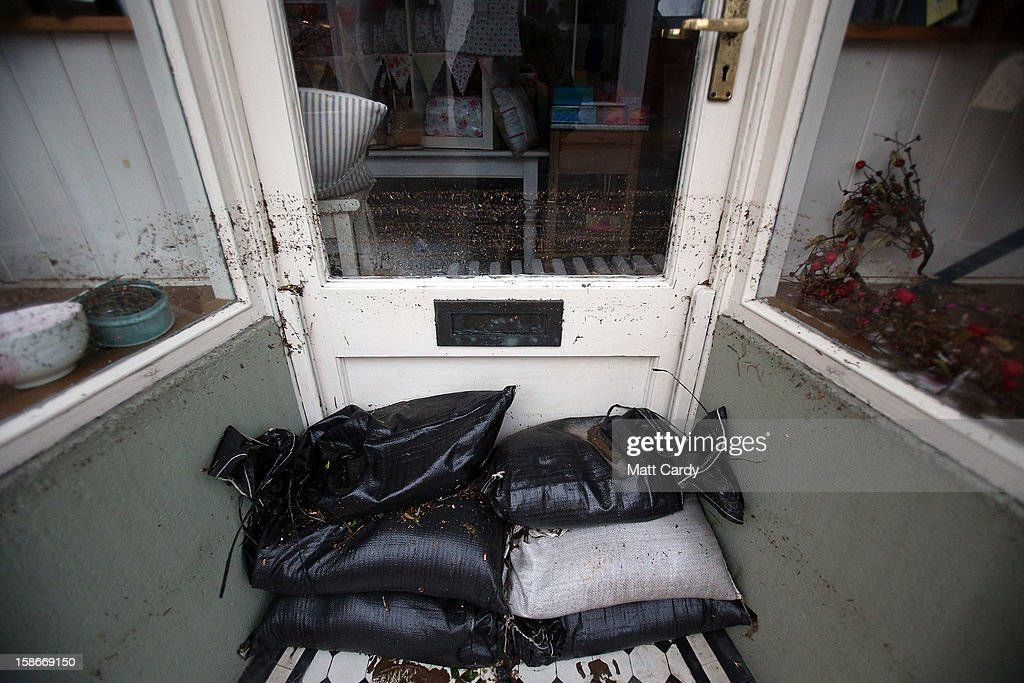 Flood damaged stock is seen behind a window after flood waters entered the shop in the centre of the Devonshire town of Braunton that was flooded yesterday on December 23, 2012 near Barnstaple, England. Flooding has brought further disruption to many parts of the UK including the South West of England that was particularly badly hit. The Met Office are warning of further bands of heavy rain tonight and the Environment Agency has issued 100s of flood warnings for England including one severe warning for Cornwall.