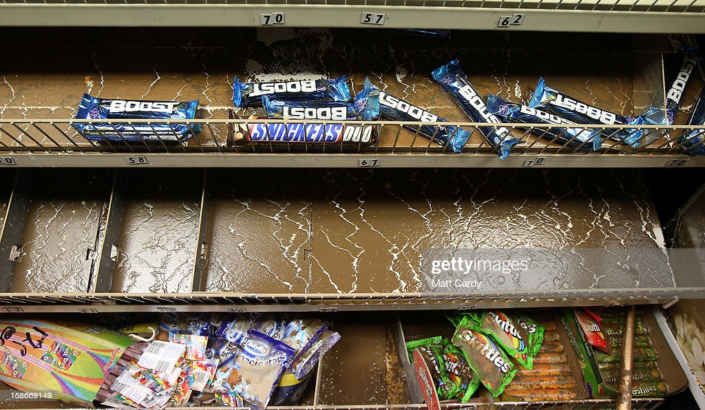 Flood damaged stock is seen in a newsagents after flood waters entered the shop in the centre of the Devonshire town of Braunton that was flooded yesterday on December 23, 2012 near Barnstaple, England. Flooding has brought further disruption to many parts of the UK including the South West of England that was particularly badly hit. The Met Office are warning of further bands of heavy rain tonight and the Environment Agency has issued 100s of flood warnings for England including one severe warning for Cornwall.