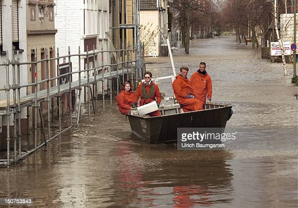 Flood of the river Rhine in Bonn Beuel A boat of the Technisches Hilfswerk supplies the residents