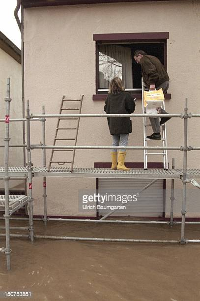 Flood of the river Rhine in Bonn Beuel Residents climbimg threw the windows in there houses