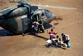 Flood victims are rescued by a South African army helicopter crew in Chibuto, Mozambique