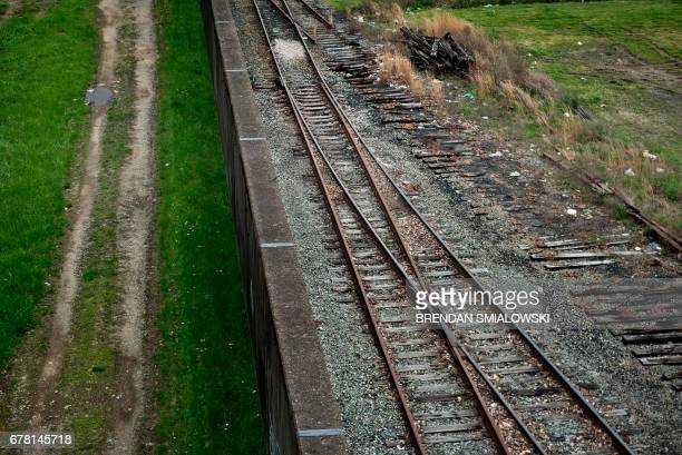 A flood wall separates railroad tracks and downtown from the Ohio River on April 19 2017 in Huntington West Virginia Huntington is a walled city...