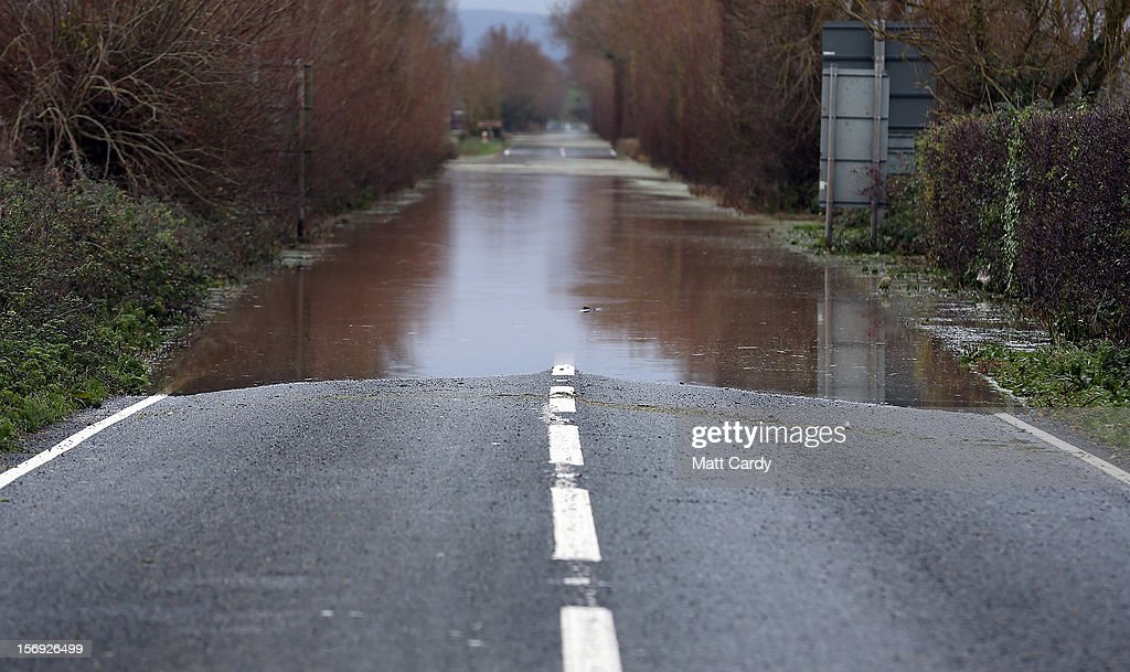 Flood water blocking the A361 on the Somerset Levels at Burrow Bridge, near Taunton, is seen on November 25, 2012 in Somerset, England. Another band of heavy rain and wind continued to bring disruption to many parts of the country today particularly in the south west which was already suffering from flooding earlier in the week.