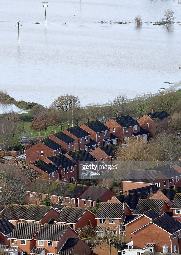 Flood water can be seen in fields behind the town of Glastonbury viewed from Glastonbury Tor, on November 25, 2012 in Somerset, England. Another band of heavy rain and wind continued to bring disruption to many parts of the country today particularly in the south west which was already suffering from flooding earlier in the week.