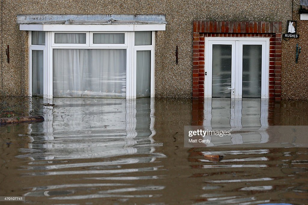 Flood water continues to surround properties in the largely evacuated village of Moorland on the Somerset Levels on February 18, 2014 in Somerset, England. Insurance bosses met with government ministers in Downing Street today to discuss their response to the continuing flooding, which has affected many parts of southern and south-west England and areas along the River Thames.