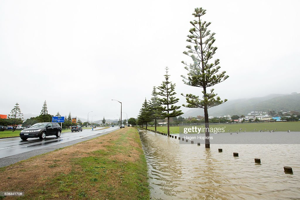 Flood water covers the boundary of Elsdon Park after heavy rain caused flooding on May 5, 2016 in Porirua, New Zealand. Severe rain warnings have been issued for the bottom of the North Island, and and several schools and parts of the city have been closed due to surface floosing