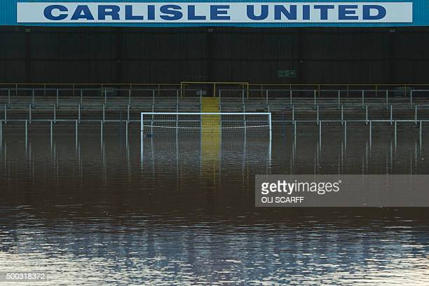 Flood water covers the pitch and some of the stands at Carlisle United Football Club's Brunton Park stadium in Carlisle north west England on...