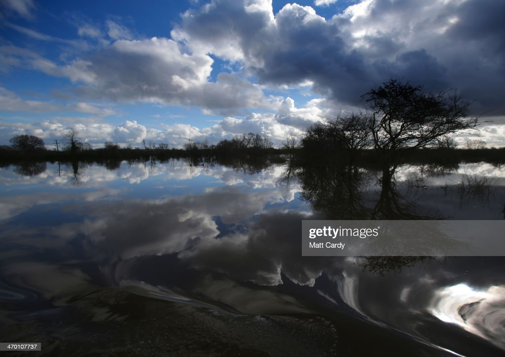 Flood water surrounds the flooded and largely evacuated village of Moorland on the Somerset Levels on February 18, 2014 in Somerset, England. Insurance bosses met with government ministers in Downing Street today to discuss their response to the continuing flooding, which has affected many parts of southern and south-west England and areas along the River Thames.