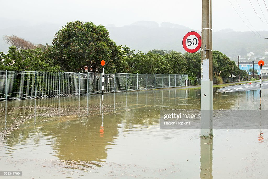 Flood waters cover Awarua Street after heavy rain caused flooding on May 5, 2016 in Porirua, New Zealand. Severe rain warnings have been issued for the bottom of the North Island, and and several schools and parts of the city have been closed due to surface floosing