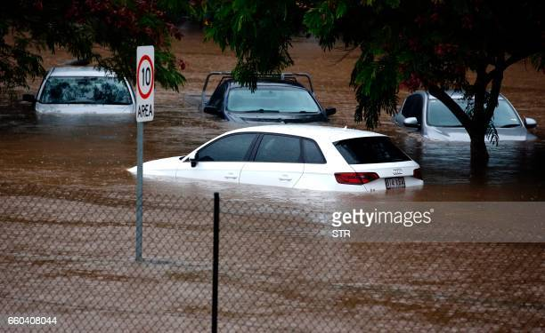 Flood waters enter in the parking lot outside the Robina Hospital on the Gold Coast as severe rain continue throughout southeast Queensland following...