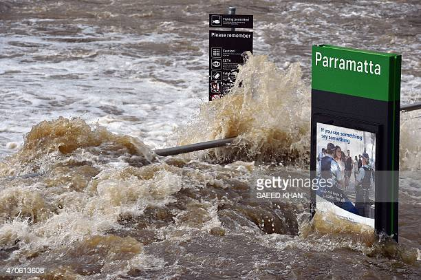 Flood waters enter the Parramatta ferry wharf in Sydney on April 22 2015 A stormtossed ship stuck outside Sydney Harbour with 2500 passengers on a...