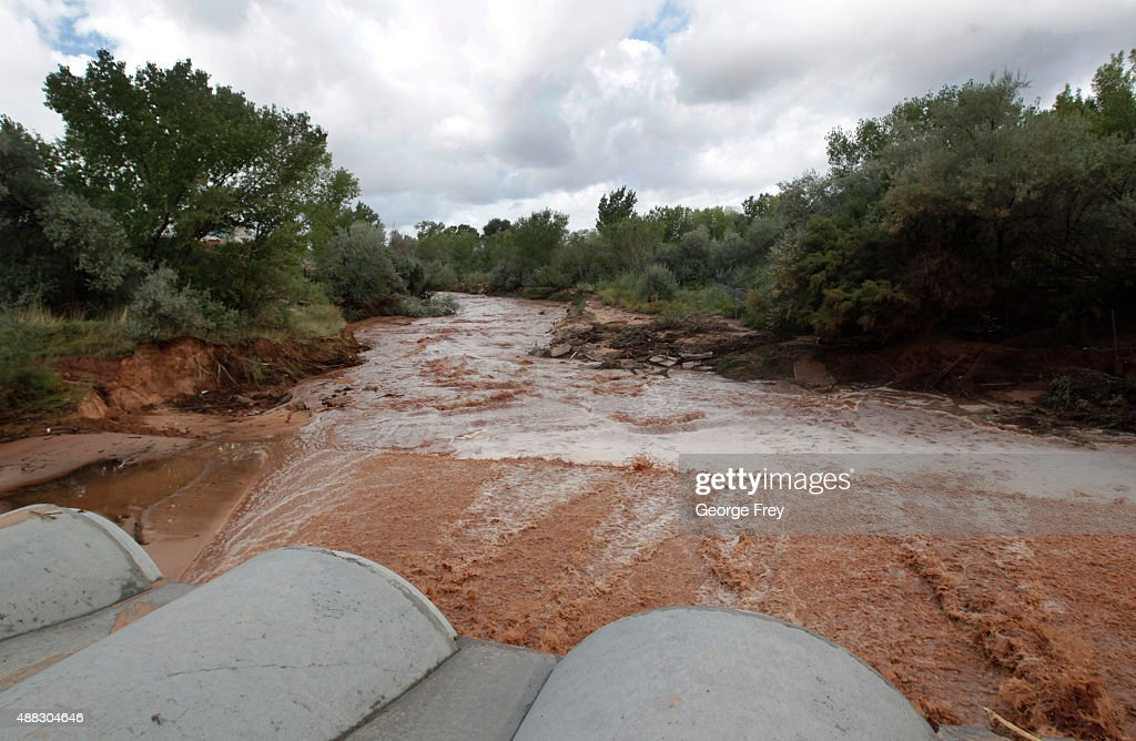 Flood waters flow through pipes down Short Creek on September 15 2015 in Colorado City Arizona Flash floods from heavy rains on the afternoon of...