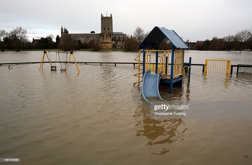 Flood waters gather on land close to Tewkesbury Abbey on December 27, 2012 in Tewkesbury, England. 2012 could be the UK's wettest year on record according to forecasters and there are currently 88 flood warnings and 207 flood alerts in England and Wales. The Environment Agency in Hereford and Worcestershire are expecting further heavy rain, delaying a clean up until after the weekend.