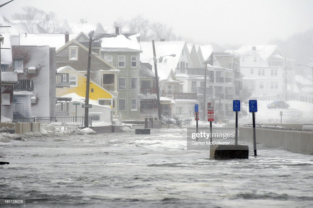 Flood waters go down Winthrop Shore Drive February 9, 2013 in Winthrop, Massachusetts. An overnight blizzard left one to two feet of snow in areas, and coastal flooding is expected as the storm lingers into the day.