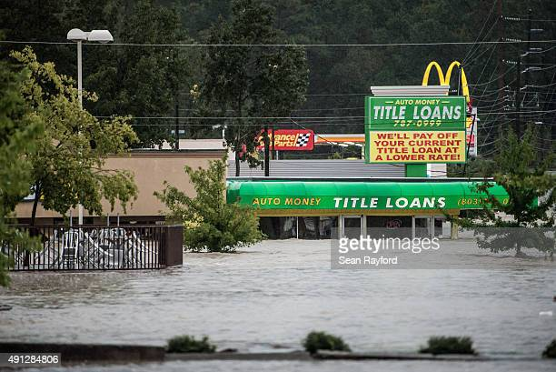 Flood waters rise around a title loan store on Garners Ferry Road October 4 2015 in Columbia South Carolina South Carolina experienced a record...
