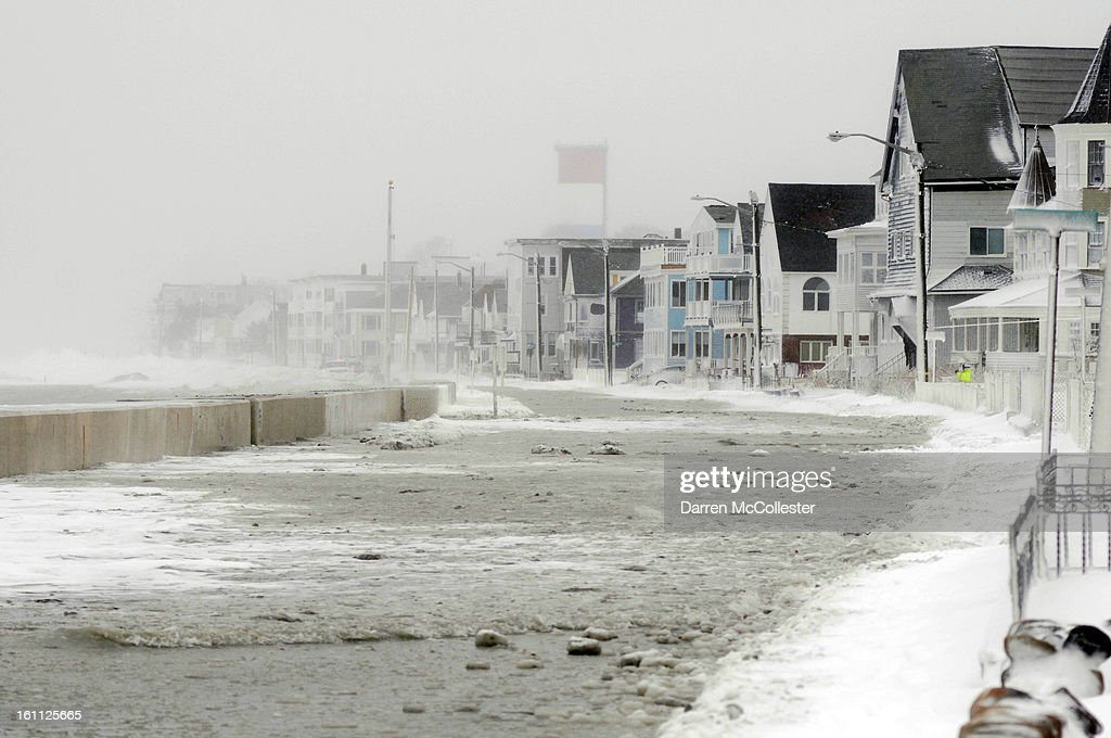Flood waters run down Winthrop Shore Drive on February 9, 2013 in Winthrop, Massachusetts. The powerful storm has knocked out power to 650,000 and dumped more than two feet of snow in parts of New England.