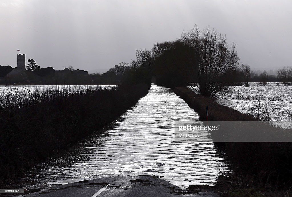 Flood waters surround the village of Muchelney which has been cut off by flooding on the Somerset Levels on December 30, 2012 near Langport, England. The Met Office is warning of the risk of further flooding towards the end of the year, meaning 2012 is set to be the wettest on record.