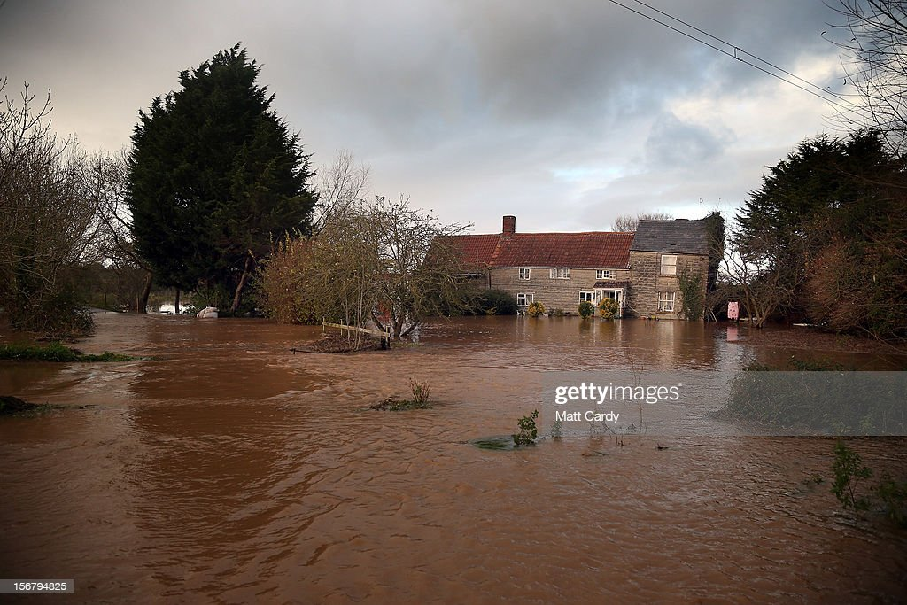 Flood waters surrounding a cottage close to the village of North Curry on November 21, 2012 near Taunton, England. Heavy rain overnight has brought widespread disruption to many parts of the UK particularly in the Somerset and Wiltshire and weather forecasters have warned of more wet and windy weather to come.