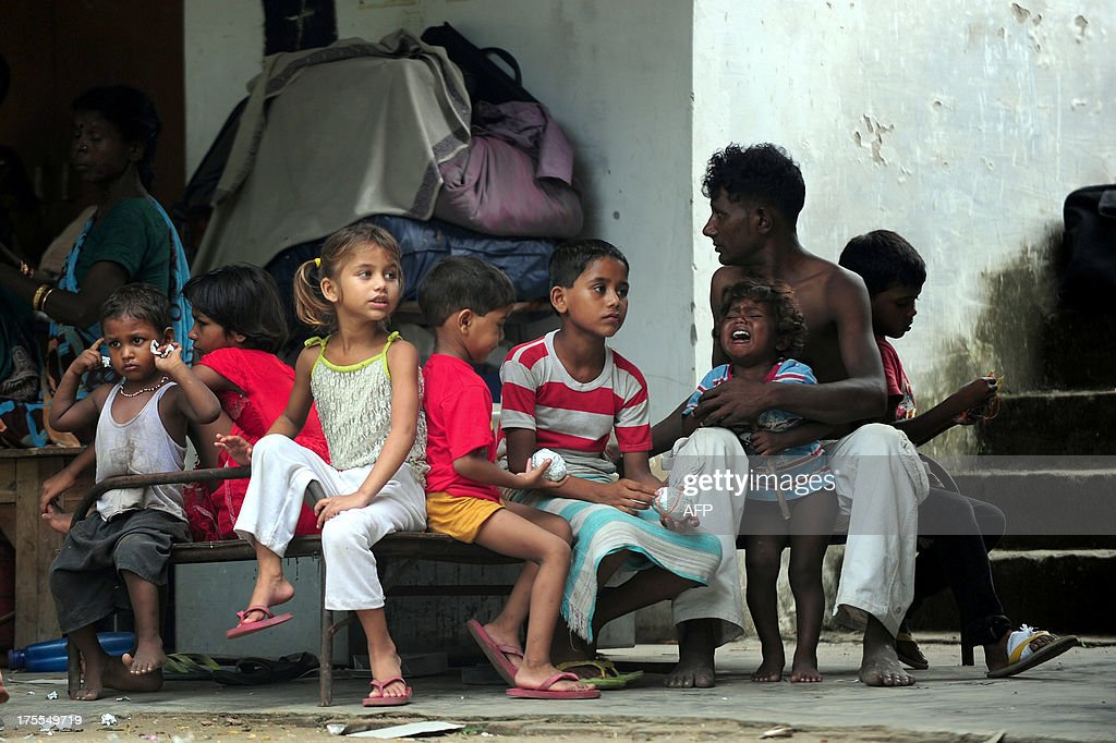 Flood-affected children sit at a local shelter in Allahabad on August 4, 2013. The monsoon, which covers the subcontinent from June to September and usually brings flooding, accounts for about 80 percent of India's annual rainfall.