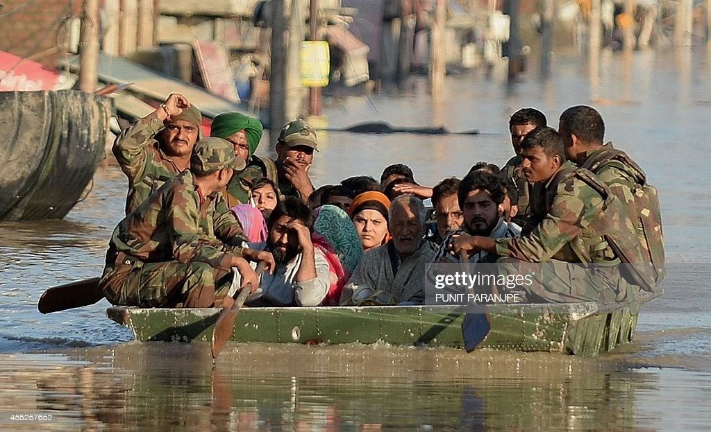 Floodaffected Kashmiri residents ride on an Indian Army raft in Srinagar on September 11 2014 The floods and landslides from days of heavy monsoon...