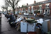 Flooddamaged possessions are stacked outside properties in Carlisle after the river Eden burst its banks following a period of exceptionally heavy...
