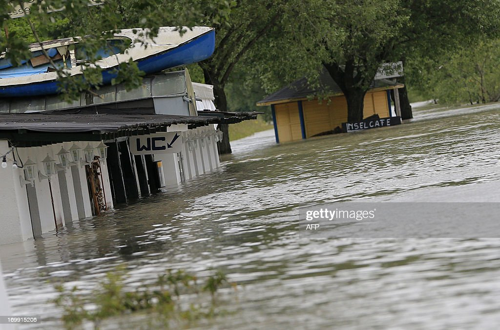 Flooded barracks and toilets of a beach bar are seen the shores of the Danube river in Vienna on June 4, 2013. Many roads were closed, particularly in the west and north of the country, and several rail services were disrupted after days of pelting rain that has left many parts of the country under flood alert. Hundreds of fire fighters and emergency services, as well as the Austrian army, have been mobilised to help clear roads, assist with evacuations and put up anti-flood barriers.