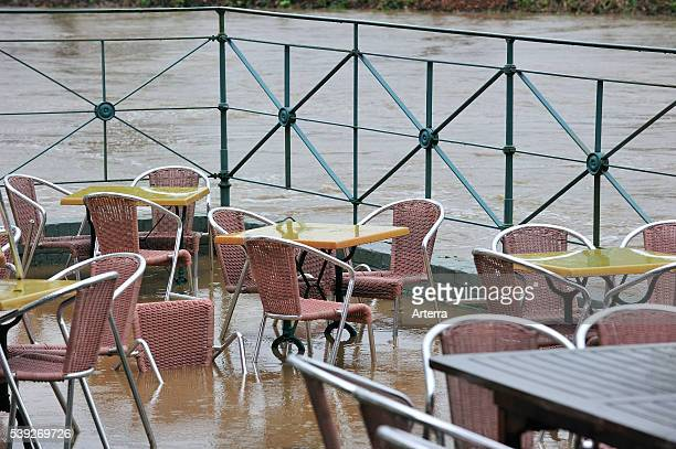 Flooded brook and terrace of restaurant at Nederzwalm Flanders Belgium